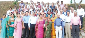 KEEPSAKE: Members of FMKMCC Alumni Association, who got together at the college in Madikeri yesterday, are seen posing for a group photo.
