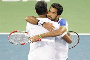 Rohan Bopanna and Aisam-Ul- Haq Qureshi hug each other after they beat Daniel Nestor and Nenad Zimonjic in the doubles final match of the Dubai Open. (AP Photo)