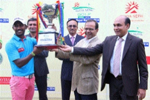 THT Minister for Communication and Information Minendra Rijal and Managing Director of Surya Nepal Pvt Ltd Abhimanyu Poddar (right) handing over the Surya Nepal Masters trophy to India's Chikkarangappa S at the Gokarna Golf Club in Kathmandu on Saturday.