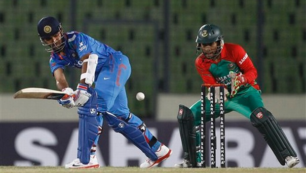 Ajinkya Rahane, left, plays a shot, as Bangladesh's captain Mushfiqur Rahim watches during their first one-day International cricket match in Dhaka | AP