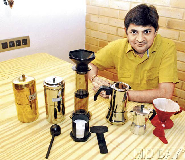 Mumbai-based brewing expert Jignesh Shah with the three coffee-making equipments (from left to right) the Indian Filter Coffee Maker (in brass and steel), Aero Press and the Moka Pot. Pics/Shadab Khan