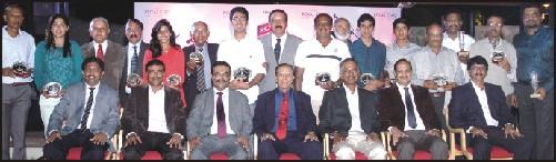 A group photo of the winners and runners of Kodagu Golf Open Championship - 2014 held at JW Golf Course in city on Aug. 23 and 24. (Sitting from left) Dr. S.L. Narayana (Chairman, Tournament Sub-Committee, JWGC) B.M. Nagesh (Hon. Secretary, JWGC), P.M. Ganapathy (President, JWGC), Dr. N.M. Caveriappa (President, Association of Kodagu Golfers of JWGC), Dr. Puttabasappa (Captain, JWGC), P. K. Somaiah (Secretary - Association of Kodagu Golfers of JWGC), H.S. Arun Kumar (Hon. Treasurer, JWGC); (Standing from left) R.N. Sudharshan, Sonam Chugh, K.M. Achaiah, C.K. Subramani, T.H. Shivani, Brig. R.V. Seetharamaiah, M.S. Yashas Chandra, M.B. Nanaiah (Treasurer - Association of Kodagu Golfer of JWGC), B.O. Ganesh Babu, Col. B.N. Somanna, M.S. Shreyas Chandra, Deepak Kumar Jain, Lt. Col. K.P. Vijay Kumar, C.K. Sridhar, Lt. Col. M.K. Poovaiah and M.S. Dinesh Kumar.