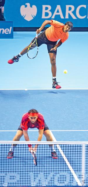 India's Rohan Bopanna (top) and his partner Florin Mergea of Romania in action during the men's doubles final in London on Sunday (PIC:AFP)