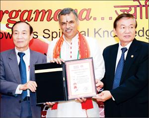 Yoga Guru Dr. Raghavendra R. Pai, Founder, Sri Vedavyasa Yoga Pratishthana, Mysuru, seen receiving the award at the 2nd Om Yoga & Wellness Hub Festival, held at Vietnam recently.