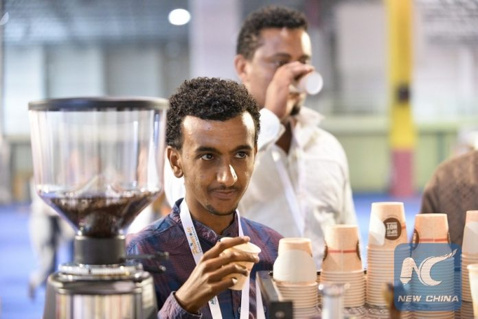 Participants taste coffee during the 15th edition of African Fine Coffee Conference and Exhibition in Addis Ababa, capital of Ethiopia, Feb. 15, 2017 (Xinhua/Michael Tewelde)