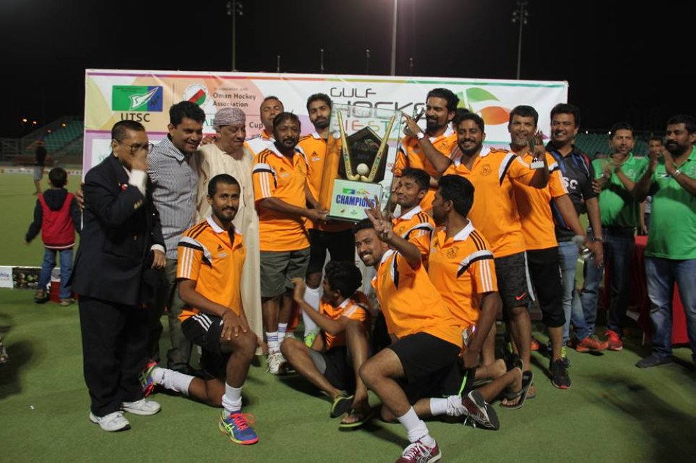 Team Coorg celebrate with their trophy after defeating UTSC in the final of the Starcare Cup Gulf Hockey Fiesta on Saturday. Photo - Supplied