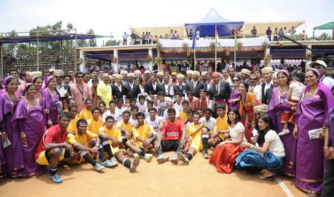 Uproarious: Kodava families with the India XI and Kodagu XI teams. Photo: K. Murali Kumar.
