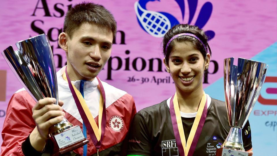 India's Joshna Chinappa and Hong Kong's Max Lee (L) pose with their trophies after the 19th Asian Squash Championships in Chennai on Sunday.(PTI)