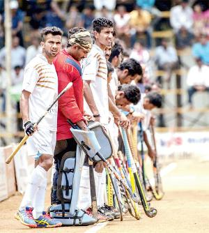 Hotbed for hockey. Nikkin Thimmaiah with his Chendanda team at the Kodava Hockey Festival final.