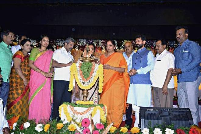 Union Minister of State for Commerce and Industry Nirmala Sitharaman inaugurating a public meeting at Mudigere in Chikkamagaluru district on Thursday.