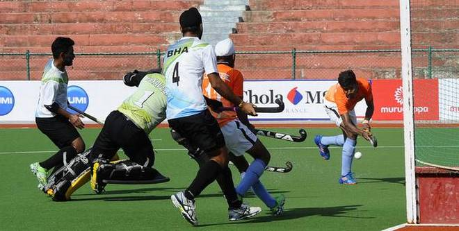 Commanding show: Ranjan Aiyappa scored a brace in Railways' demolition of Bengaluru Hockey Association.   | Photo Credit: V. Ganesan