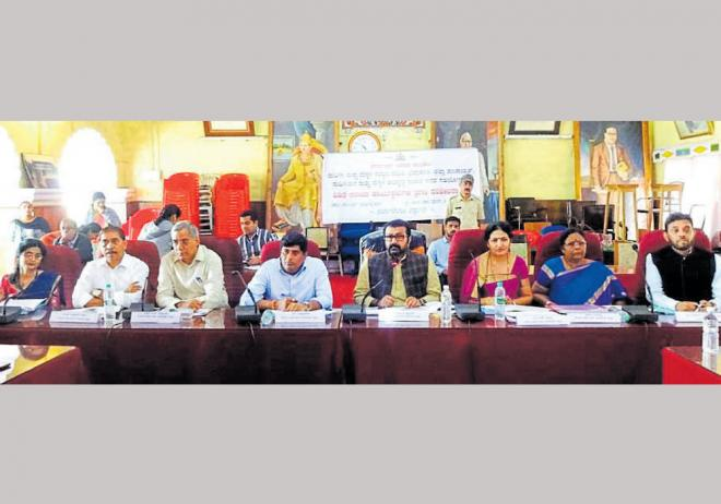 Women and Child Development Committee chairman N A Haris speaks at a meeting in Madikeri on Thursday. DH photo