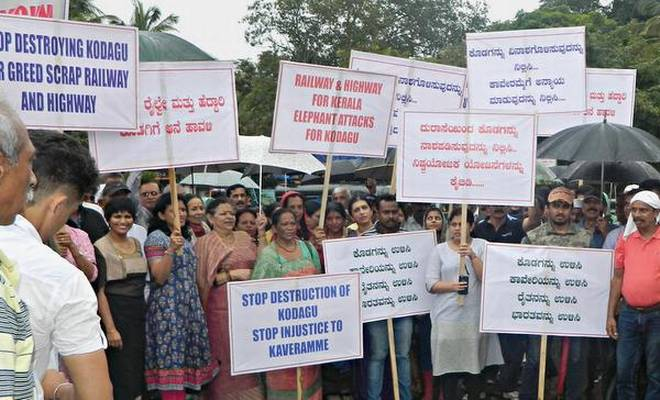 Up in arms:Activists protesting as part of the 'Save Kodagu, Save Cauvery' campaign at Kutta in Kodagu on Saturday.Special Arrangement
