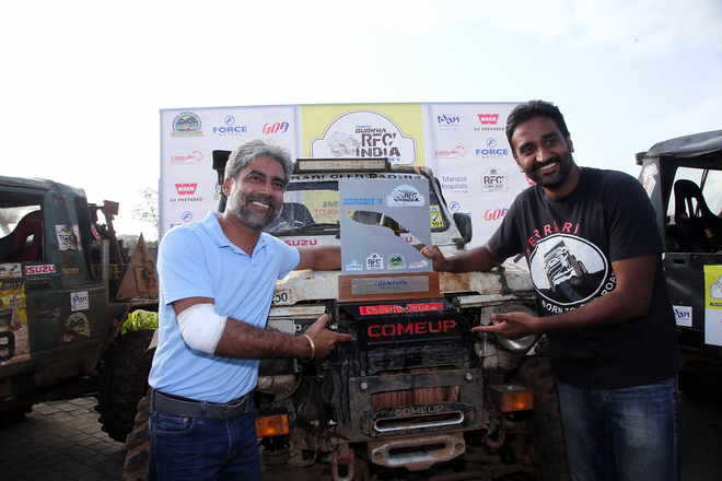 Gurmeet Virdi (left) with his co-driver Kirpal in Goa. Tribune Photo
