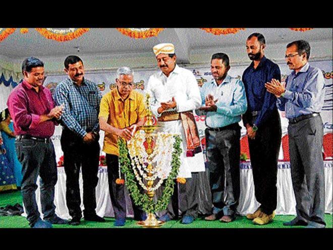 Purushottama Bilimale, researcher and head of Kannada department, Jawaharlal Nehru University (JNU) inaugurates a multilingual poets' symposium organised by Karnataka Arebhashe Culture and Literature Academy in Gowda Samaja, Madikeri, on Sunday. dh photo