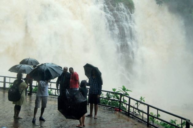 Tourists at Abbey Falls near T Shettigeri, with rain catching up by monsoon end, all falls in the State are putting up their best show