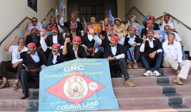 Codava National Council members stage a protest in Madikeri on Tuesday to urge the government to conduct a genealogical study of Kodavas.